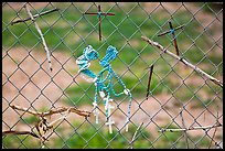 Chain-link fence with rosaries and improvised crosses, Sanctuario de Chimayo. New Mexico, USA (color)