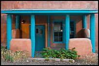 Blue and adobe house porch. Santa Fe, New Mexico, USA (color)