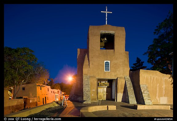 Oldest church and house in the US by night. Santa Fe, New Mexico, USA