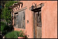 Door, window, and vigas (wooden beams). Santa Fe, New Mexico, USA (color)