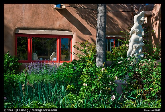 Front yard with sculpture, Canyon Road. Santa Fe, New Mexico, USA
