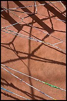 Shadows of vigas (wooden beams) and strings made of plastic bags. Santa Fe, New Mexico, USA