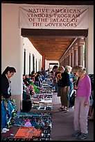 Tourists browse wares sold under native american vendors program of the palace of the governors. Santa Fe, New Mexico, USA