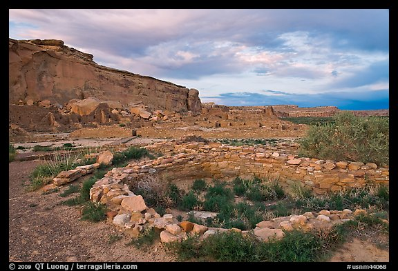 Great Kiva and cliff at sunset, Pueblo Bonito. Chaco Culture National Historic Park, New Mexico, USA