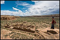 Man overlooking Chetro Ketl. Chaco Culture National Historic Park, New Mexico, USA ( color)