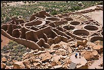 Tourists inspecting the complex room arrangement of Pueblo Bonito. Chaco Culture National Historic Park, New Mexico, USA (color)