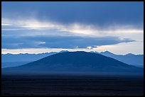 Ute Mountain with rain clouds at sunrise. Rio Grande Del Norte National Monument, New Mexico, USA ( color)