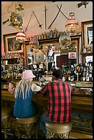 Man and woman sitting in saloon. Virginia City, Nevada, USA