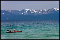 Kayak, turquoise waters and snowy mountains, East Shore, Lake Tahoe, Nevada. USA (color)