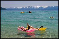 Children playing in water, and distant snowy mountains, Sand Harbor, Lake Tahoe, Nevada. USA (color)
