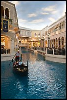 Gondolier singing song to couple during ride inside Venetian casino. Las Vegas, Nevada, USA