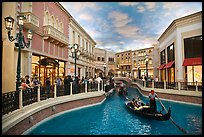 Gondolas and Grand Canal bordered by shops in the Venetian casino. Las Vegas, Nevada, USA