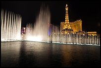 Bellagio fountains and Paris hotel by night. Las Vegas, Nevada, USA (color)
