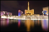 Bellagio dancing fountains and hotels reflected in lake. Las Vegas, Nevada, USA ( color)
