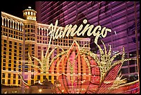 Flamingo hotel lights and Bellagio hotel reflections. Las Vegas, Nevada, USA