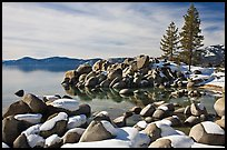 Snow and boulders on shore, Sand Harbor, Lake Tahoe-Nevada State Park, Nevada. USA ( color)