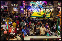 Families crowd arcade during holidays. Reno, Nevada, USA ( color)