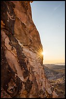 Cliff with Falling Man petroglyph and sun. Gold Butte National Monument, Nevada, USA ( )