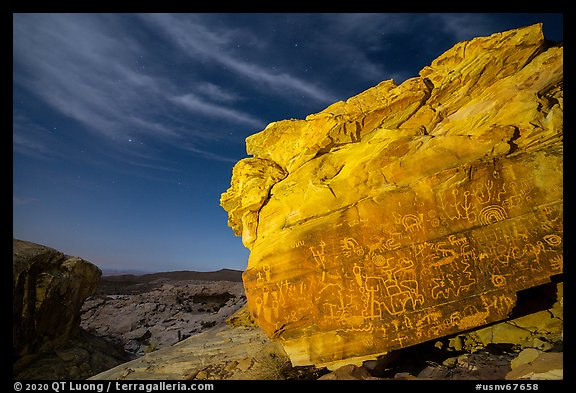 Rock with petroglyphs at night with clouds. Gold Butte National Monument, Nevada, USA (color)