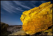 Rock with petroglyphs at night with clouds. Gold Butte National Monument, Nevada, USA ( )