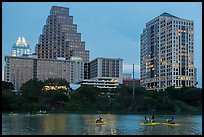 Water pedaling in front of skyline at dusk. Austin, Texas, USA ( color)