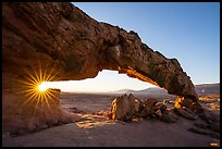 Sunstar through Sunset Arch. Grand Staircase Escalante National Monument, Utah, USA ( color)