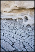 Cracked mud and cliff with holes. Grand Staircase Escalante National Monument, Utah, USA ( color)