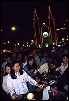 Women on motorbike in front of St Joseph Cathedral on Christmas eve. Ho Chi Minh City, Vietnam (color)