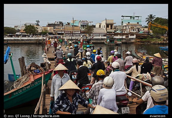 Crowd crossing the mobile bridge, Duong Dong. Phu Quoc Island, Vietnam