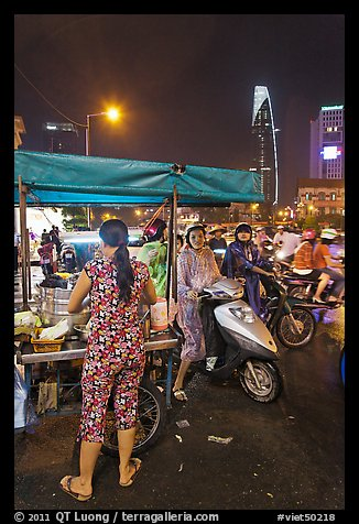 Street food stand at night. Ho Chi Minh City, Vietnam