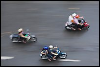 Motorbike riders seen from above with speed blur. Ho Chi Minh City, Vietnam