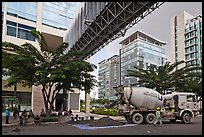 Asphalt truck and new urban area, Phu My Hung, district 7. Ho Chi Minh City, Vietnam (color)