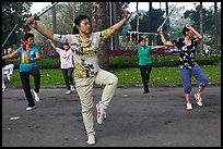 People practicisng Tai Chi with swords, Cong Vien Van Hoa Park. Ho Chi Minh City, Vietnam (color)
