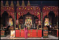 Woman at altar, Tam Son Hoi Quan Pagoda. Cholon, District 5, Ho Chi Minh City, Vietnam (color)