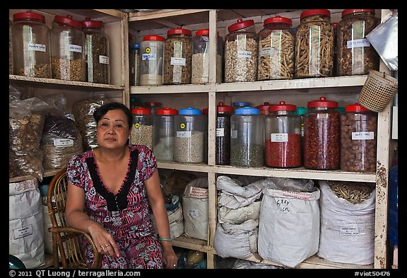 Woman with jars of traditional medicinal supplies. Cholon, Ho Chi Minh City, Vietnam