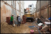Buiding in construction in narrow space. Ho Chi Minh City, Vietnam ( color)