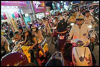 Street filled with motorcycles at rush hour. Ho Chi Minh City, Vietnam