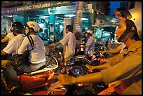 Motorcyle riders in traffic gridlock. Ho Chi Minh City, Vietnam