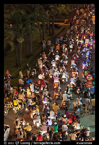 Heavy motorcycle traffic on Nguyen Hue boulevard at night. Ho Chi Minh City, Vietnam (color)