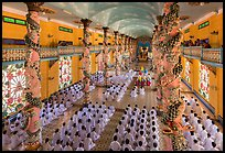 Noon ceremony inside Cao Dai Holy See temple. Tay Ninh, Vietnam (color)