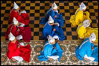 Cao Dai dignitaries wearing red (Confucian), blue (Taois) and yellow (Buddhist). Tay Ninh, Vietnam (color)