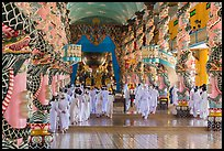 Cao Dai followers during a service inside Holy See. Tay Ninh, Vietnam (color)