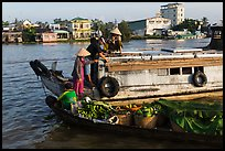 People buying fruit on boats, Cai Rang floating market. Can Tho, Vietnam (color)