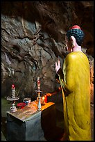 Buddha statue in narrow cave, Marble Mountains. Da Nang, Vietnam ( color)