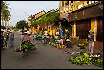Fruit and vegetable vendors in old town. Hoi An, Vietnam (color)