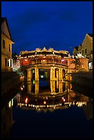 Illuminated Japanese covered bridge reflected in canal. Hoi An, Vietnam (color)