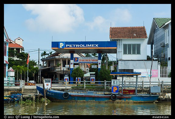 Road and river petrol station. Hoi An, Vietnam