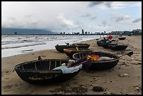 Coracle boats and city skyline. Da Nang, Vietnam (color)