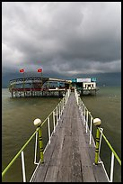 Boarwal, offshore restaurant, and threatening clouds. Vietnam ( color)