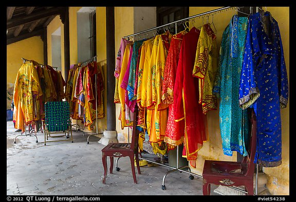 Coat hangers with silk robes in imperial style, citadel. Hue, Vietnam